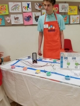 Student explaining circuits